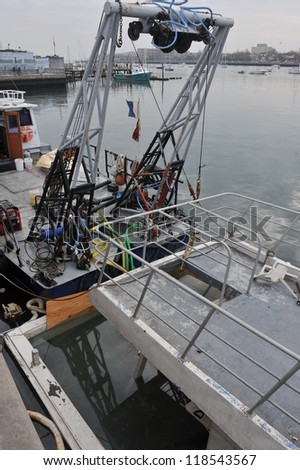 BROOKLYN, NY - NOVEMBER 11: Elevating of sunken boat in the Sheepshead bay channel due to impact from Hurricane Sandy in Brooklyn, New York, U.S., on November 11, 2012. - stock photo
