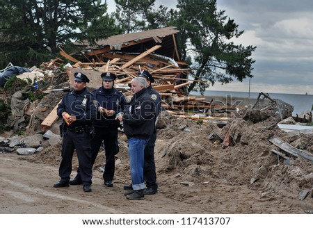 BROOKLYN, NY - NOVEMBER 01: NYPD secure serious damage in the buildings at the Seagate neighborhood due to impact from Hurricane Sandy in Brooklyn, New York, U.S., on Thursday, November 01, 2012. - stock photo