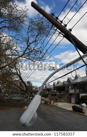 BROOKLYN, NY - NOVEMBER 03: Trees and electric poles felt down to the ground in the Sheapsheadbay neighborhood due to strong wind from Hurricane Sandy in Brooklyn, NY, U.S., on November 03, 2012. - stock photo