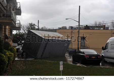 BROOKLYN, NY - OCTOBER 30: Big container was pulled on the ground in the Sheapsheadbay neighborhood due to flooding from Hurricane Sandy in Brooklyn, New York, U.S., on Tuesday, October 30, 2012. - stock photo