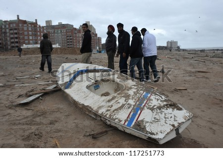 BROOKLYN, NY - OCTOBER 30: Debris and boat litters the beach in the Sheapsheadbay neighborhood due to flooding from Hurricane Sandy in Brooklyn, New York, U.S., on Tuesday, October 30, 2012. - stock photo