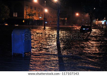BROOKLYN, NY - OCTOBER 29: Flooded streets, caused by Hurricane Sandy, are seen on October 29, 2012, in the corner of Brigham street and  Emmons Avenue of Brooklyn NY, United States. - stock photo