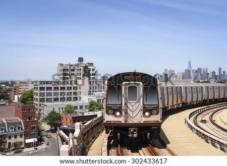 Brooklyn skyline with subway train - stock photo