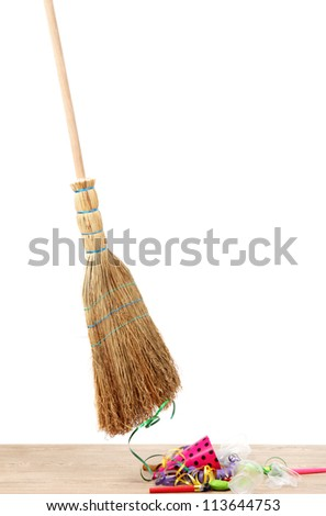 Broom sweep the trash after a party on white background close-up - stock photo