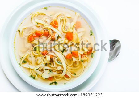 Broth - chicken soup with noodles on a plate - stock photo