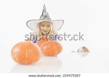 Brother and sister celebrating halloween - stock photo