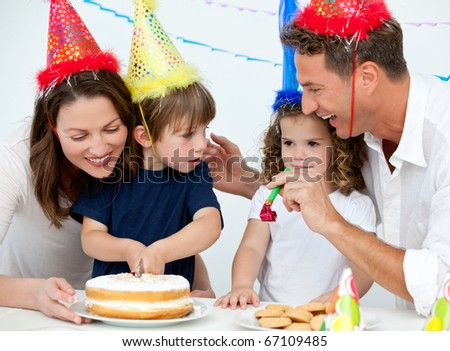 Brother and sister celebrating their birthday at home - stock photo