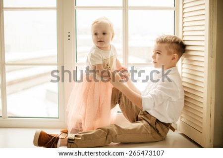 brother and sister, happy family - stock photo