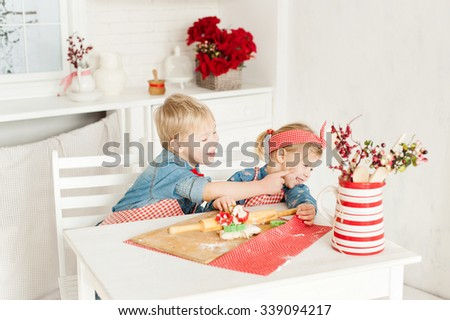 brother and sister having fun in the kitchen - stock photo