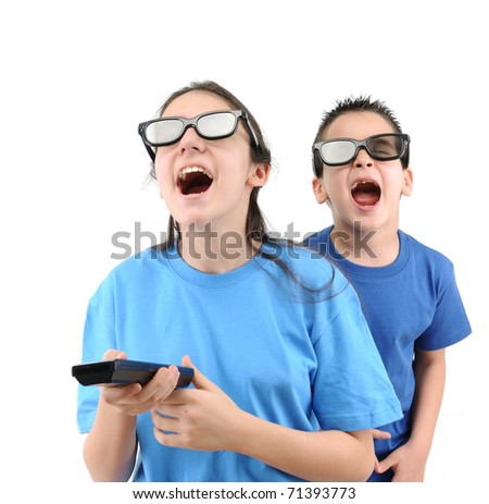 Brother and sister having fun while watching TV isolated on white background - a series of TV remote images. - stock photo