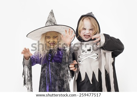 Brother and sister in halloween costume for halloween - stock photo