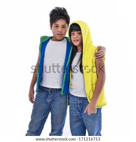 brother and sister in jeans together - stock photo
