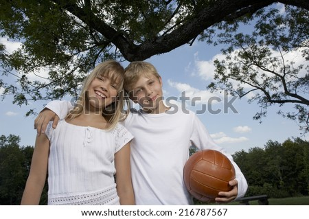 Brother and sister in the park. - stock photo
