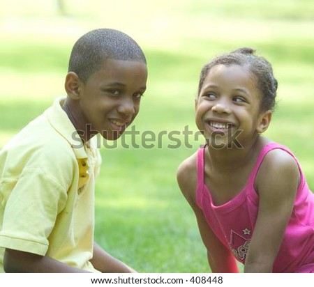 Brother and sister in the park - stock photo