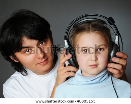 brother and sister listen to the music - stock photo