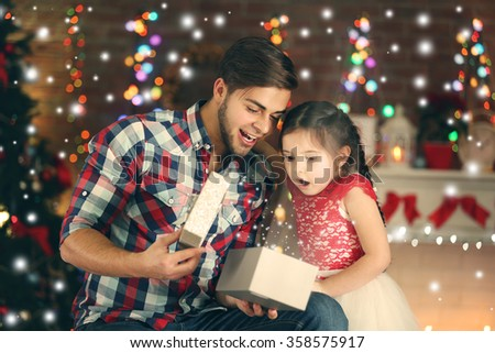 Brother and sister on Christmas interior background - stock photo