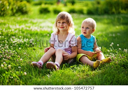 Brother and sister outdoors - stock photo