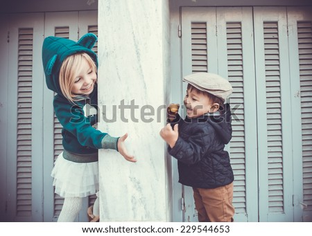 Brother and sister outdoors in city - stock photo