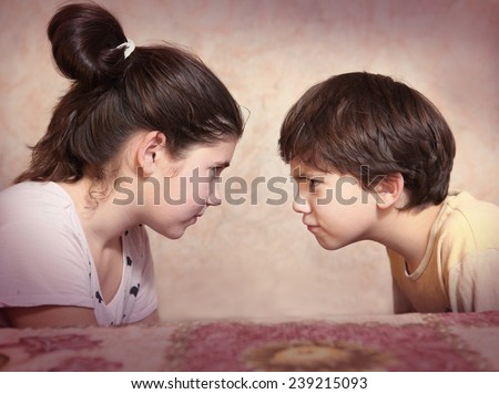 brother and sister  quarrel - stock photo