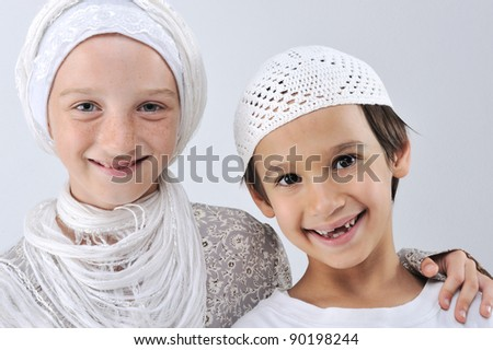 Brother and sister together, arabic muslim traditional clothes - stock photo