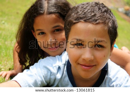 Brother and Sister together in their backyard - stock photo