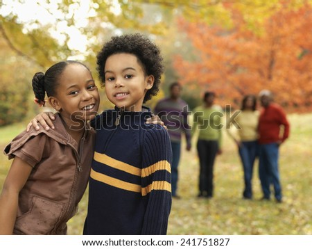Brother and Sister with Family - stock photo