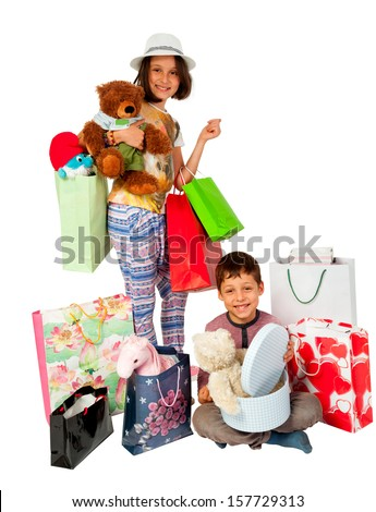 Brother and sister with shopping bags after a tory shopping session - stock photo