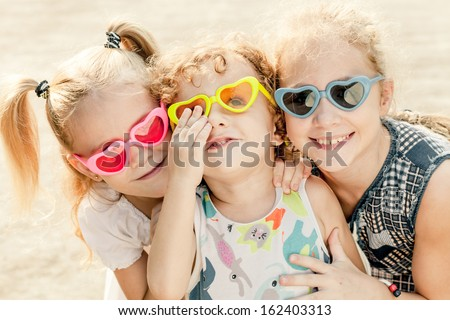 Brother And Sisters Together Forever. Three happy children in the sunglasses - stock photo