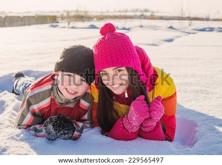 brother and sitter on snow  - stock photo