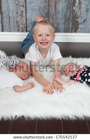 Brother and twins together - stock photo
