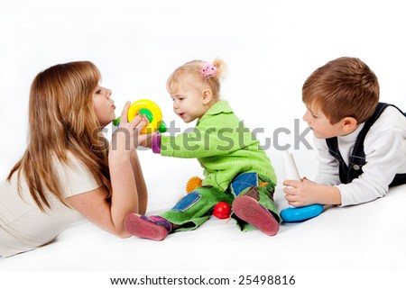 Brother and two sisters playing on white - stock photo