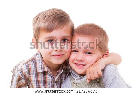 brother hugging her brother on a white background - stock photo