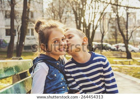 Brother sister kissing in the park  - stock photo