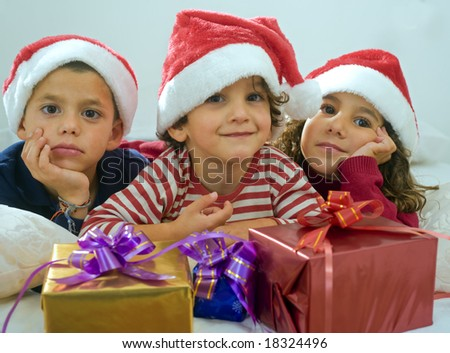 brothers and sister with presents the bed - stock photo