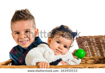 Brothers baby inside basket - stock photo