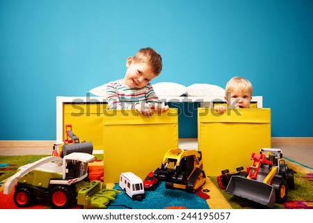 Brothers hidden in boxes - stock photo