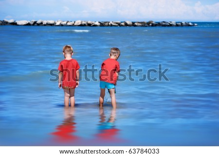 Brothers playing in the Adriatic Sea. - stock photo