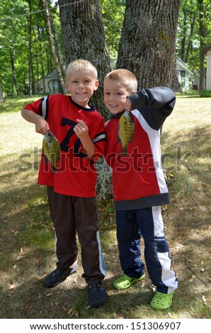 brothers up North with crappie they caught fishing - stock photo