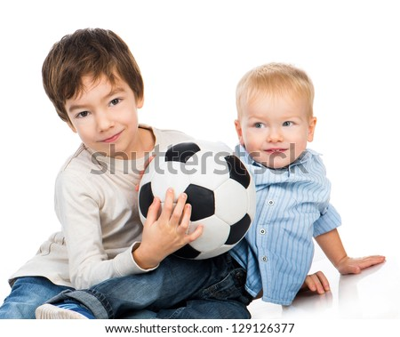 brothers with a soccer ball on a white background - stock photo