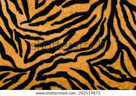 Brown and black tiger pattern. Fur animal print as background. - stock photo