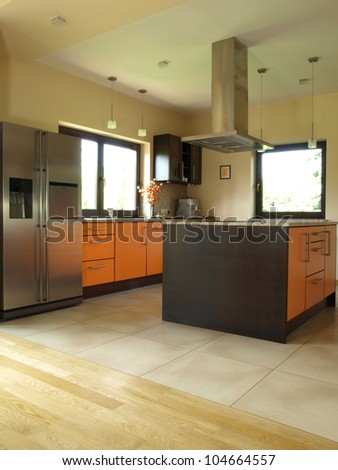 Brown and orange kitchen in modern style - stock photo
