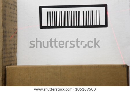 Brown and white barcode scan by a thin laser. - stock photo