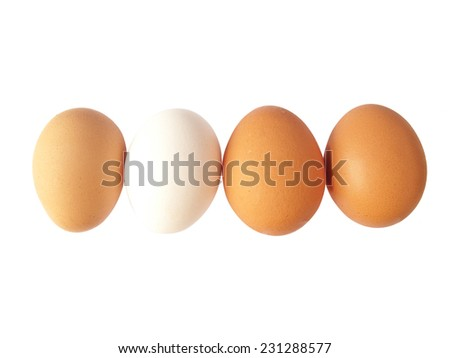Brown and white chicken eggs isolated in white - stock photo