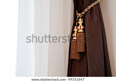 brown and white curtain with the window lighting - stock photo