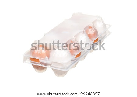 Brown and white eggs in the plastic box over white background - stock photo