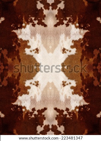 Brown and white kaleidoscope cow hide pattern - stock photo