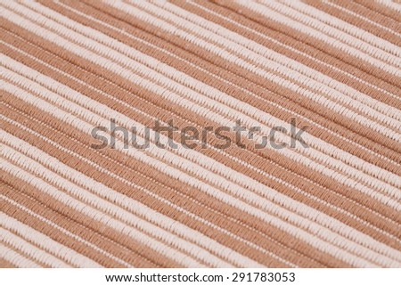 Brown and white knitted cloth as a background. - stock photo