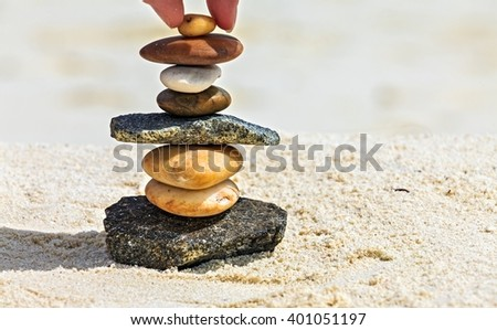 Brown and  white stones are on a beach - stock photo