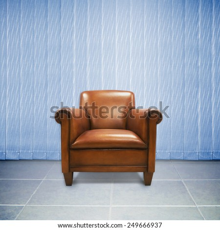Brown antique leather chair with curtains on the back for an elegant interior - stock photo