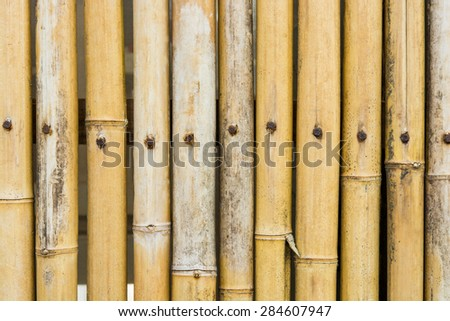 brown bamboo fence texture on a background - stock photo